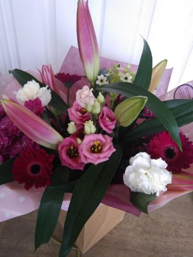 Amazing Lilies in a Hand-Tied Water Bag